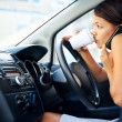 Stock Photo: Coffee driving woman