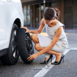 Flat tire woman — Stock Photo #28423053