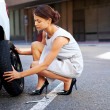 Flat tire woman — Stock Photo #28423059