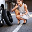 Businesswoman flat tire — Stock Photo