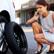 Businesswoman flat tire — Stock Photo #28423083