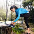 Athlete stretching outdoors — Stock Photo