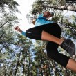 Jumping trail runner — Stock Photo #28423811