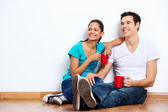 New home mixed couple — Stock Photo