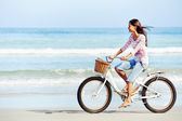 Beach bicycle woman — Stock Photo