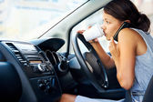 Coffee driving woman — Stock Photo