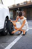 Flat tire woman — Stock Photo