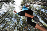 Jumping trail runner — Stock Photo