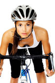 Pretty active cyclist holding to handlebars on a road bike in st — Stock Photo