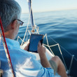 Tablet computer on boat — Stock Photo #28452203