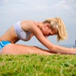 Stock Photo: Blond girl stretches