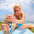 Blond girl stretches — Stock Photo