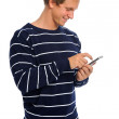 Attractive man with smart phone  — Stock Photo