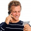 Attractive man reading out credit card number — Stock Photo