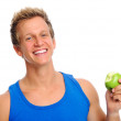 Sporty man with apple — Stock Photo #28456353