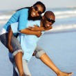 Stock Photo: Couple walking on beach.