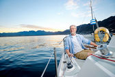 Happy sailing man boat — Stock Photo