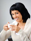 Woman poses with cup — Stock Photo