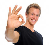 Handsome man with OK sign — Stock Photo