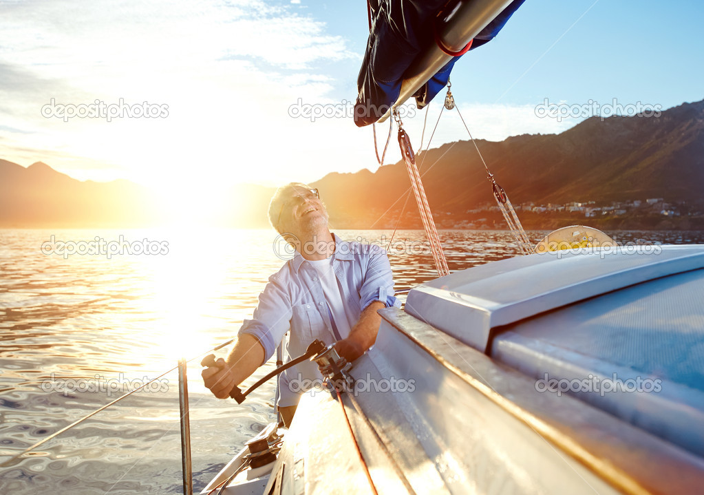 Sailing Boat Sunrise Sunrise Sailing Man on Boat in Ocean With Flare And Sunlight on Calm Morning
