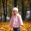 Infant baby girl in golden autumn park — Stock Photo #14246655