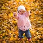 Infant baby girl in golden autumn park — Stock Photo #14246699