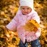 Infant baby girl in golden autumn park — Stock Photo #14246707