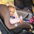 Infant baby girl in car seat — Stockfoto