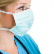 Woman doctor wearing protective face mask — Stock Photo #14247011