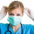 Woman doctor wearing protective face mask — Stock Photo #14247023
