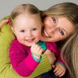 Happy infant child with mother — Stock Photo