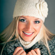 Portrait of beautiful blond woman in warm clothes on blue background — Stock Photo #4373261