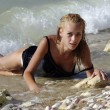 Stock Photo: Wet blond laying in surf