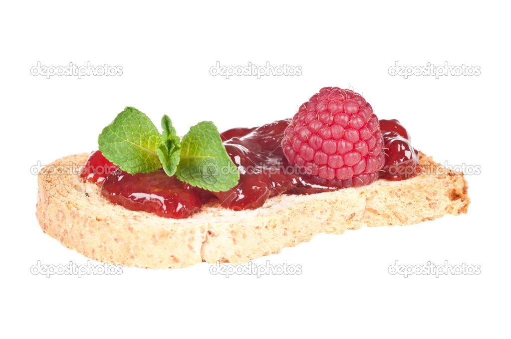 Roasted bread with jam or marmelade garnished with mint and raspberry — Stock Photo #18802489