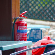 Fire extinguisher in the rain - Stock Photo