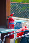 Fire extinguisher in the rain — Stock Photo