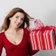 Woman with a big present — Stock Photo