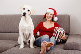 Woman with her dog on Christmas Day — Stock Photo