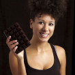 Woman with a chocolate bar — Stock Photo
