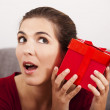 Trying to guess what is inside the present — Stock Photo