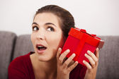 Trying to guess what is inside the present — Foto de Stock