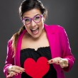 Funny woman holding a heart — 图库照片
