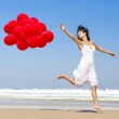 Running and Jumping with ballons — Stock Photo
