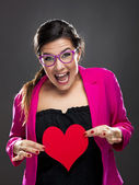 Funny woman holding a heart — Stock Photo