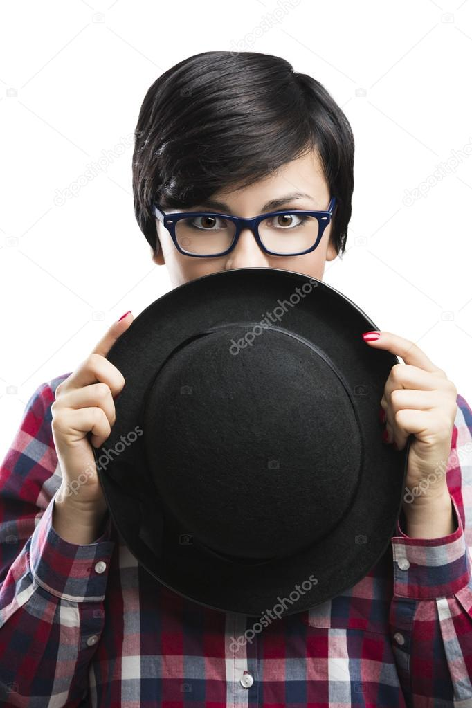 Beautiful girl with a funny face wearing a hat and nerd glasses, isolated over white background — Stock Photo #19121767