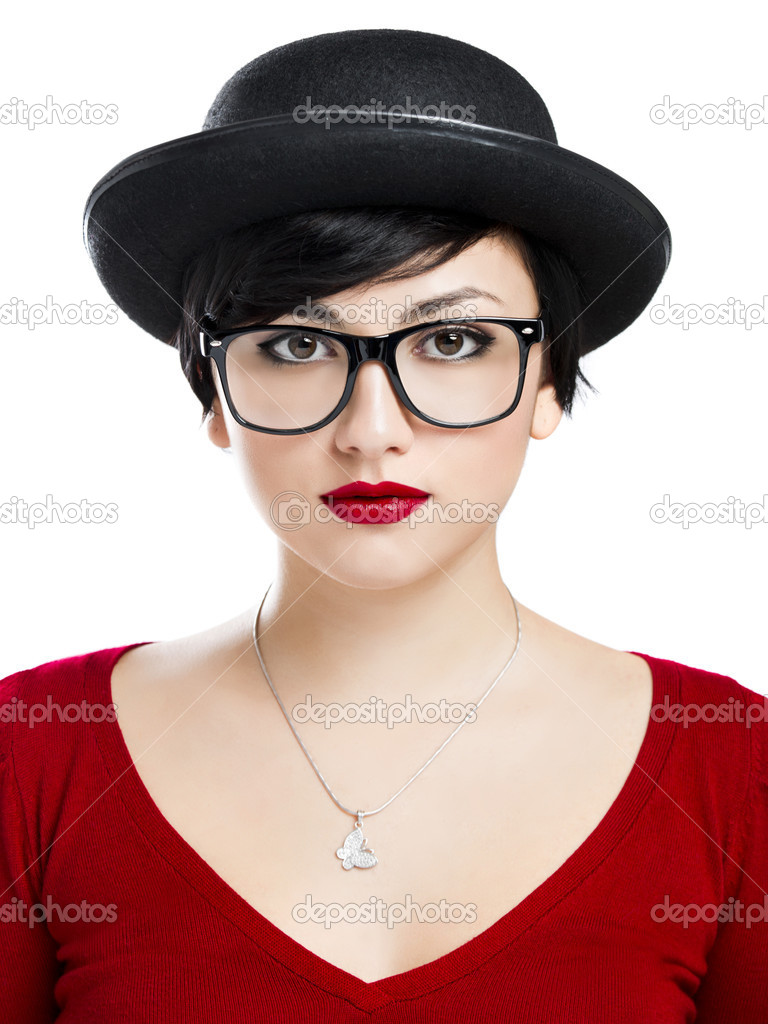 Beautiful girl wearing a hat and nerd glasses, isolated over white background  Stock Photo #19121769
