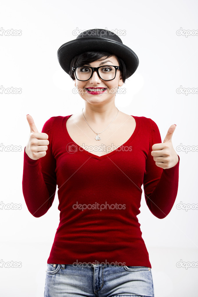 Beautiful girl wearing a hat and nerd glasses and thumbs up, isolated on white — Stock Photo #19121841