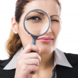 Business holding a magnifying glass — Stock Photo #24605151