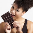 Woman eating chcolate — Stock Photo