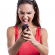 Yelling to a cellphone — Stock Photo #24629501